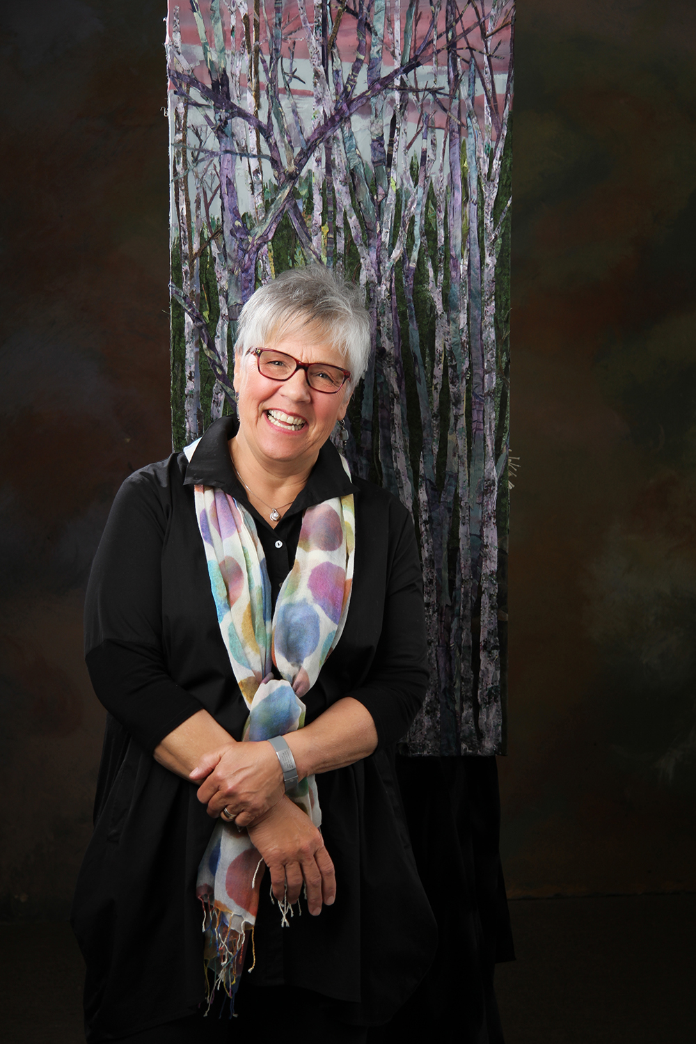 Pam Collins Headshot with Birch Trees