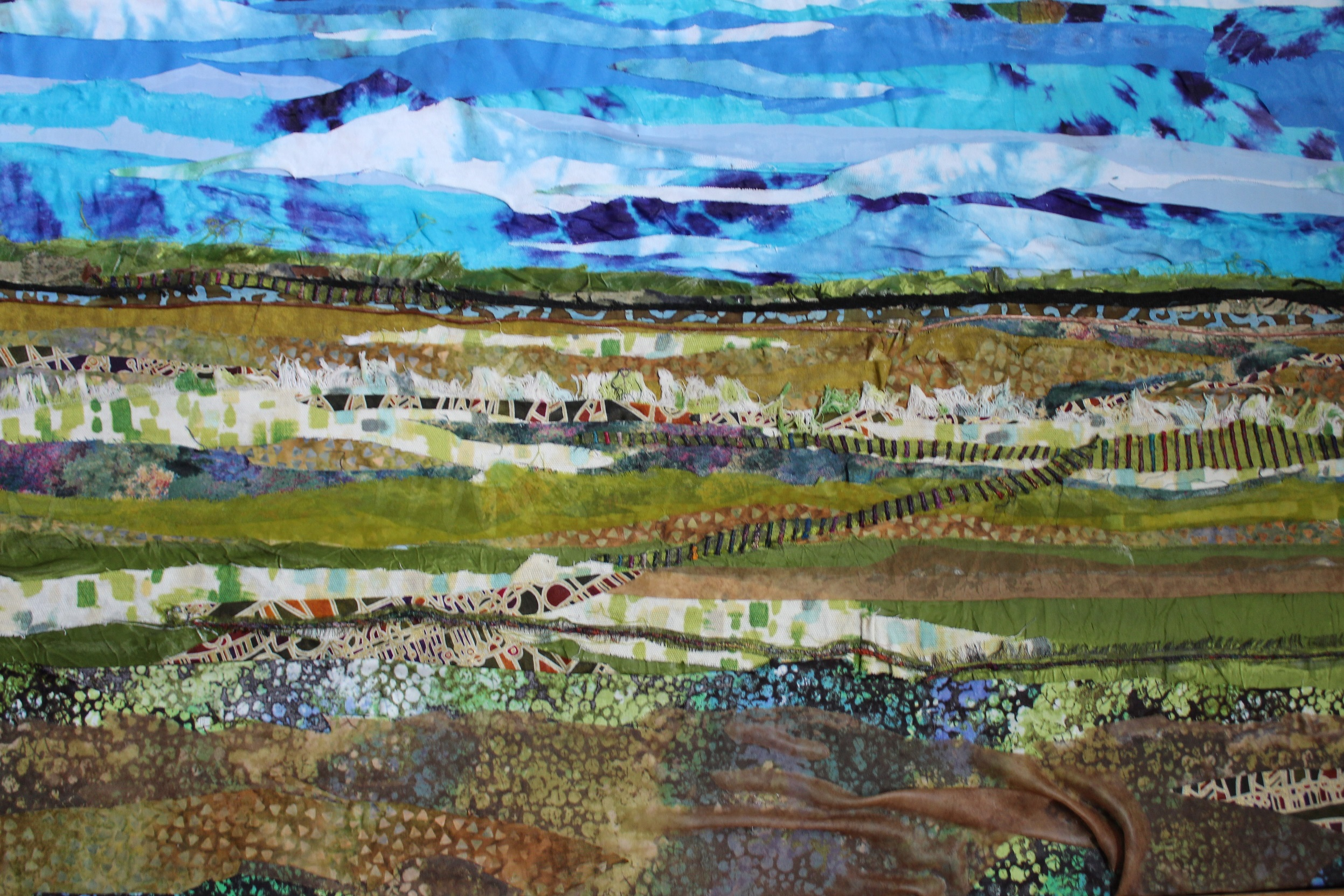 """Fabric painting by artist Pam Collins titled """"Green Prairies"""""""