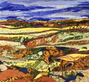 "Fabric art by artist Pam Collins titled ""Fall on the Prairie"""
